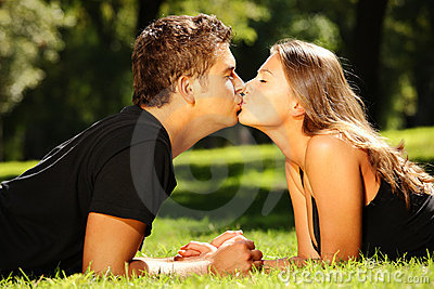 Young nice couple kissing in the park