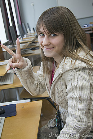 Young nice girl the student works with computer