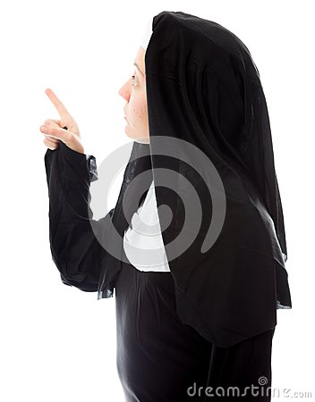Young nun thinking and pointing up