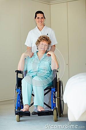 Young nurse with a senior woman on a wheelchair