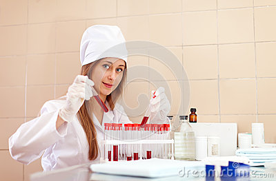 Nurse with test tube in laboratory