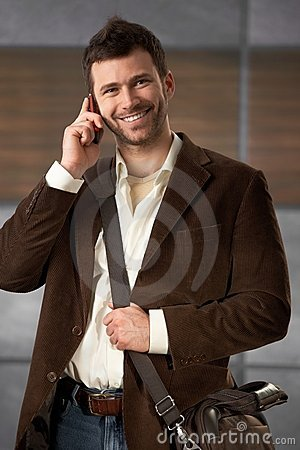 Young office worker on phone
