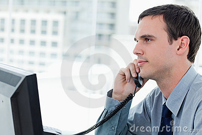 Young office worker on the phone