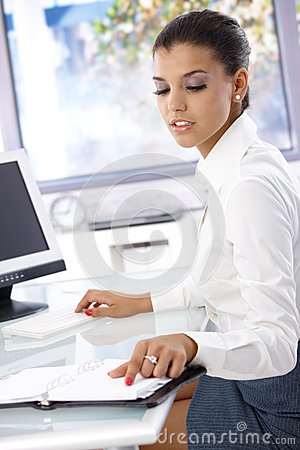 Young office worker sitting at desk