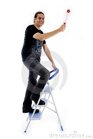 Young painter standing on ladder