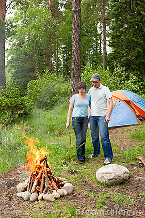 Free Young Pair At A Fire In A Forest Stock Photo - 15725830