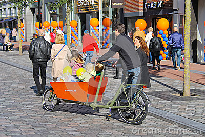 Young parents carry children in the bicycle stroller Editorial Photography