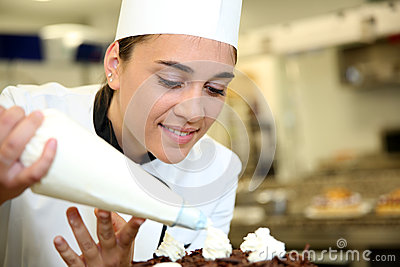 Young pastry cook at work