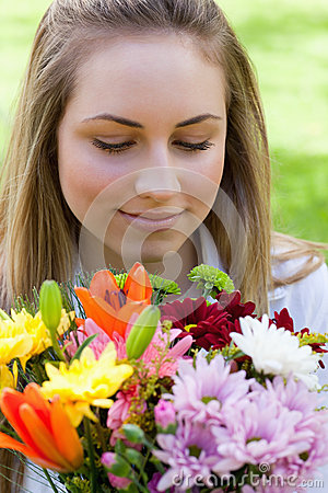 Free Young Peaceful Woman Smelling A Bunch Of Flowers While Closing H Royalty Free Stock Photo - 25331945