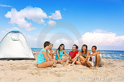 Young people camping on beach