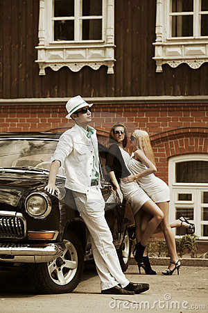 Young people with a classic car