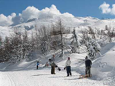 Young people enjoying in winter activities