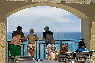 Young People Gaze at Ocean