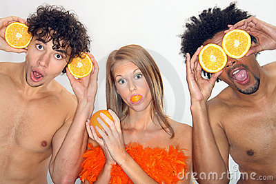 Young people have fun with oranges