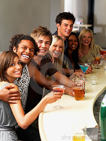 Young people having drinks at a bar
