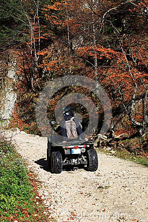 Young people having fun with ATV motorcycle