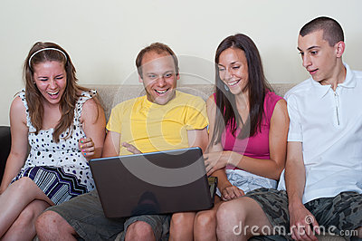 Young people having fun with laptop