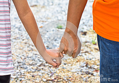 Young people holding hands