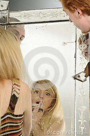 Young people looking in mirror