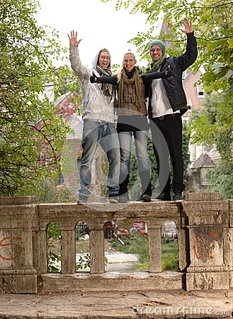 Young people in park smiling