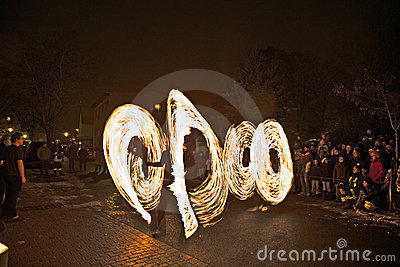 Young people perform a fire spectacle Editorial Photo