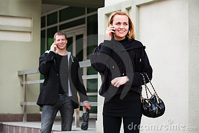 Young man and woman calling on the cell phone