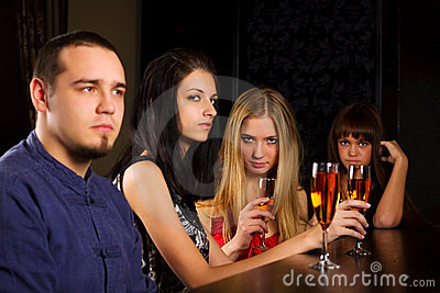 Young people relaxing in a bar.