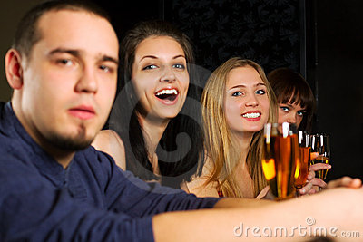 Young fashion people relaxing in a night bar