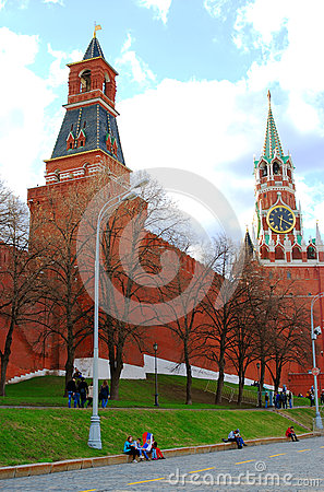 Young people sitting by the Moscow Kremlin wall Editorial Stock Image
