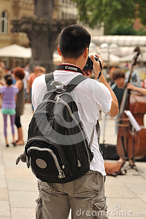 Street photographer. Back view  Editorial Stock Image