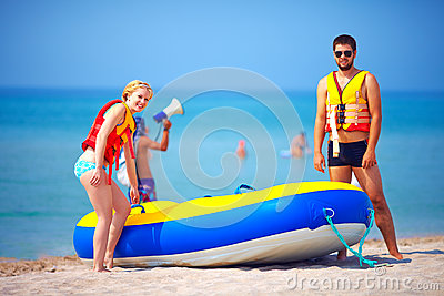 Young people on summer beach