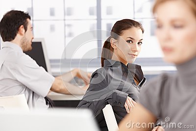 Young people working in office smiling