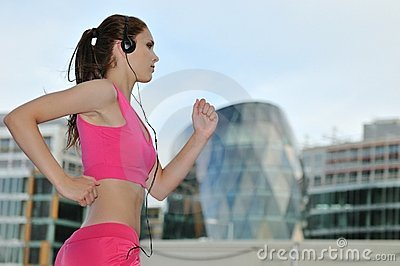 Young person listening msic running on street