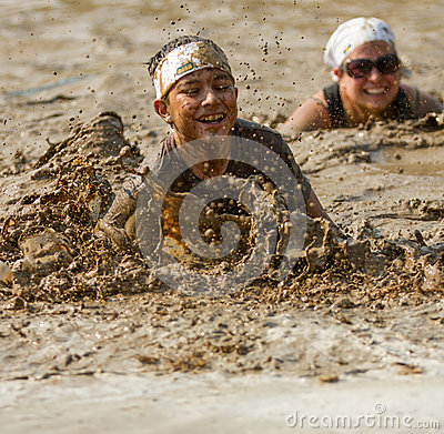Free Young Person Trying To Swim The Mud Royalty Free Stock Image - 45366936
