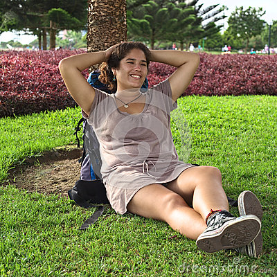 Young Peruvian Woman with Backpack in Park