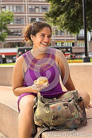 Young Peruvian Woman with Empanada