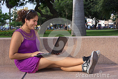 Young Peruvian Woman with Laptop in Park