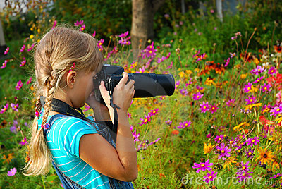 Young photographer in the garden