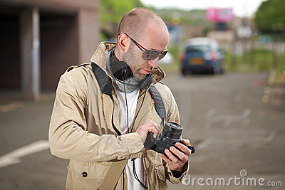 Young photographer with his dslr camera, outdoor