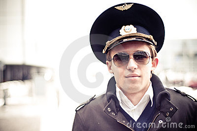 Young pilot in Kastrup airport against terminal, c