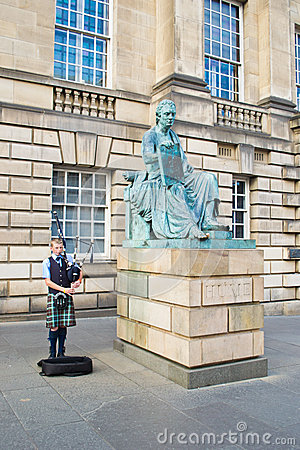 Young piper during Edinburgh Festival Editorial Photography