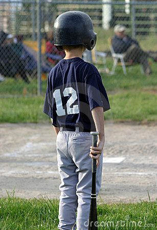 Young Player Waiting to Bat
