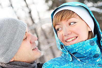 Young playful couple has a fun. Winter