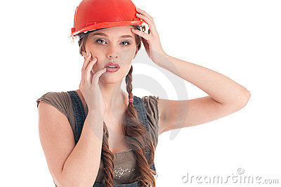 Young playful worker woman in coverall and helmet
