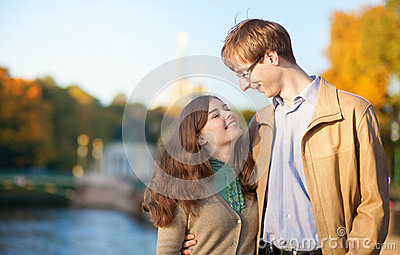 Young positive couple enjoying warm autumn day