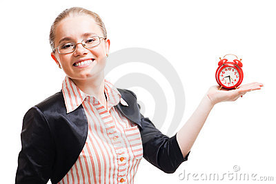 Young positive woman with alarm clock