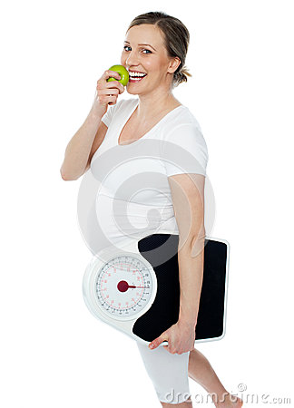 Young pregnant woman enjoy fresh green apple