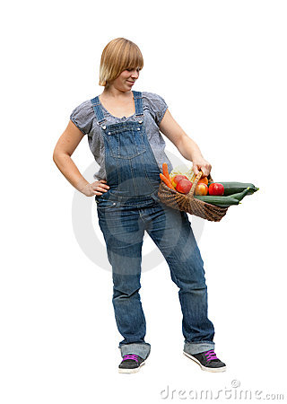 Young pregnant woman with a fruit basket