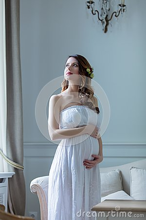 Free Young Pregnant Woman In White Dress Royalty Free Stock Images - 105271989