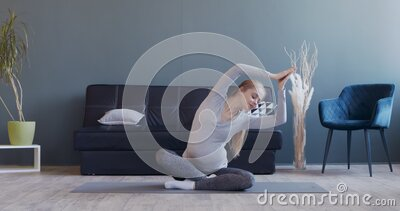 young man practicing yoga watching tutorial on laptop